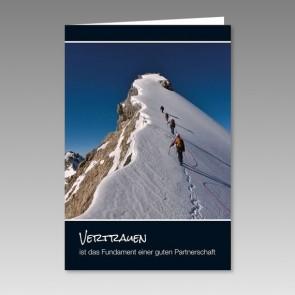 Weihnachtskarte mit Bergsteigern