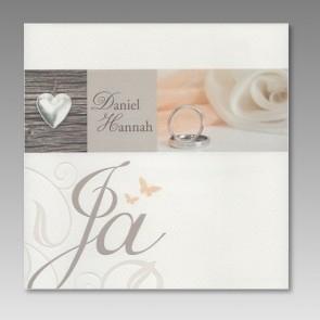 Einladen zur Hochzeit mit aufgedruckten Herz und Ringen